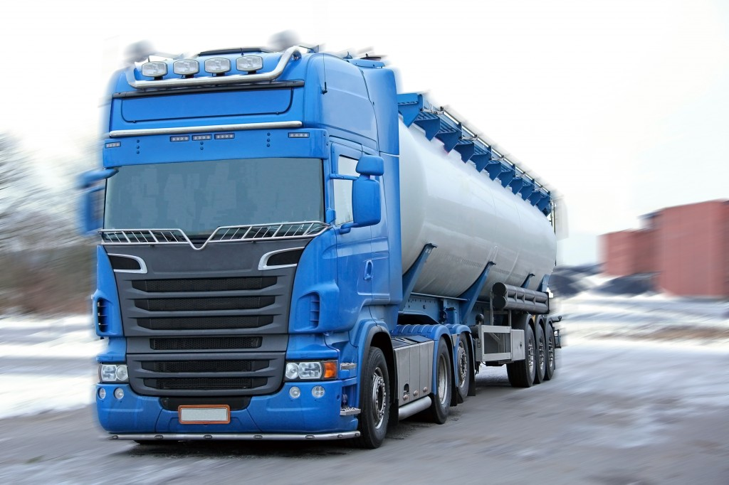 bigstock-Blue-Tanker-Truck-with-Motion--40840615